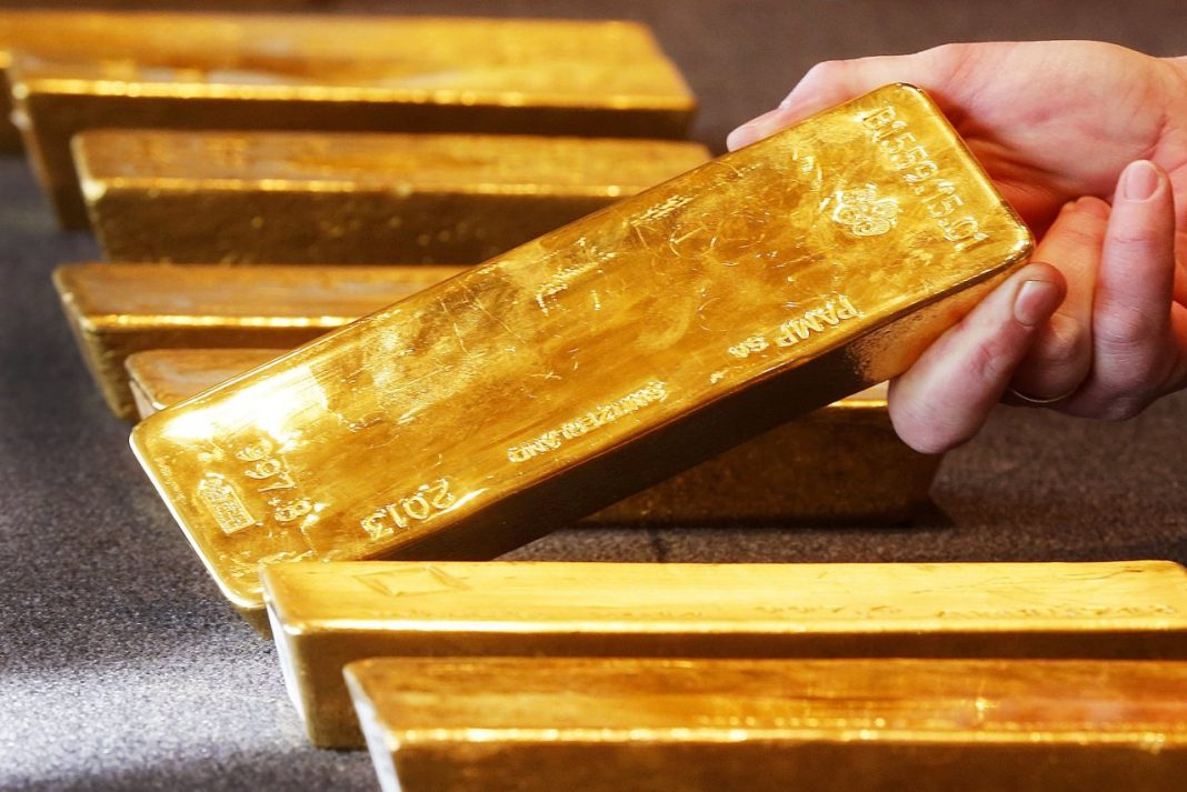 Gold prices down amid positive risk sentiment