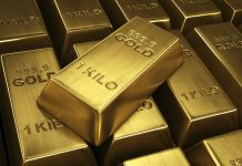Gold bulls capped by trade optimism but stays afloat