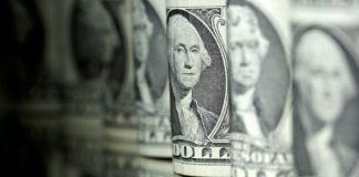 Dollar dips vs yen as investors reach for safe havens on virus scare