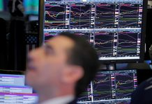 Stock futures tumble on fears of financial hit from China virus