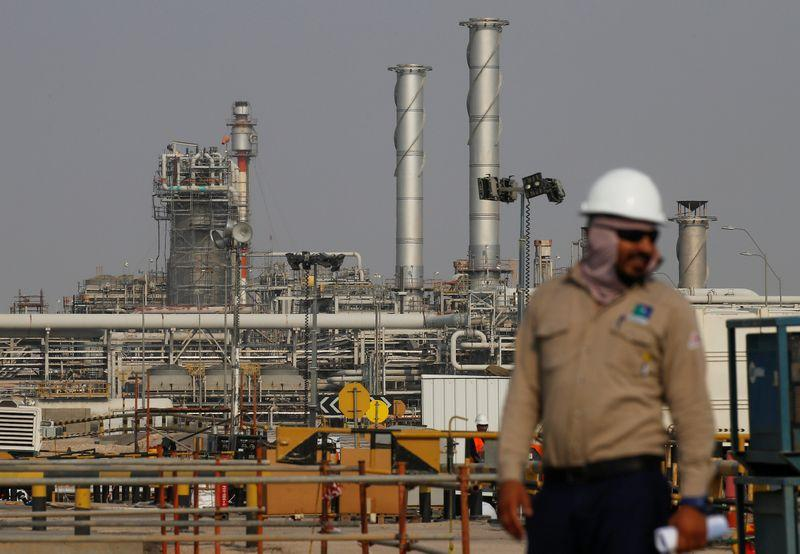 An employee looks on at Saudi Aramco oil facility in Abqaiq, Saudi Arabia