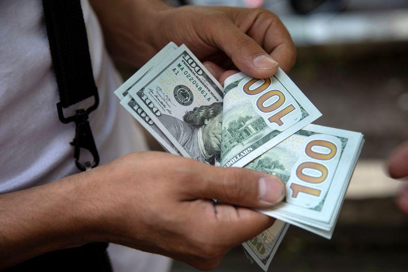 A man counts U.S. dollars in Tehran, Iran July 7, 2019. Nazanin Tabatabaee/ WANA