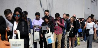 The number of Americans filing for unemployment benefits dropped to a nine-month low last week.