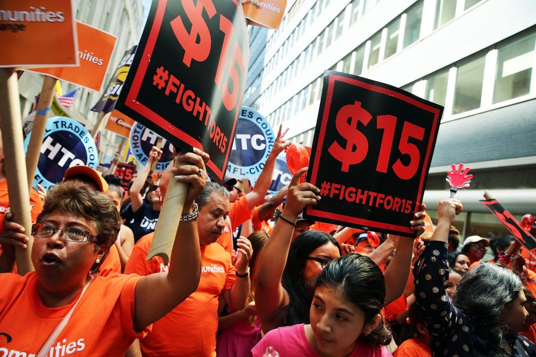A rally for a $15 minimum hourly wage in New York City in 2015. The city raised its minimum wage to $15 in 2018, while New York State raised its minimum wage to $11.80 in December 2019, and that will increase statewide at the end of 2020 to $12.50