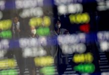 Asian shares inched higher on Friday, on course to post the second straight week of gains, helped by hopes governments will make provisions to soften the impact on their economies from the coronavirus epidemic