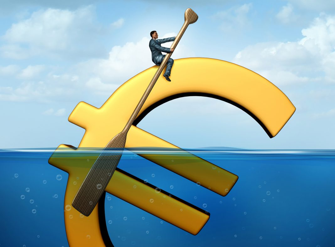 Euro currency guidance financial concept as a european money icon floating in the water with a businessman using an oar to steer and guide the economic symbol.
