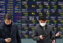 Asian shares and U.S. stock futures rose on Wednesday, as investors tried to shake off worries about the coronavirus epidemic after a slight decline in the number of new cases