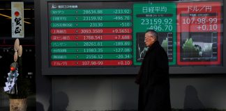 A decoration for celebrating new year is seen next to a stock index board outside a brokerage in Tokyo, Japan, January 6, 2020