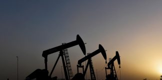 Pump jacks operate at sunset in Midland, Texas, U.S., February 11, 2019