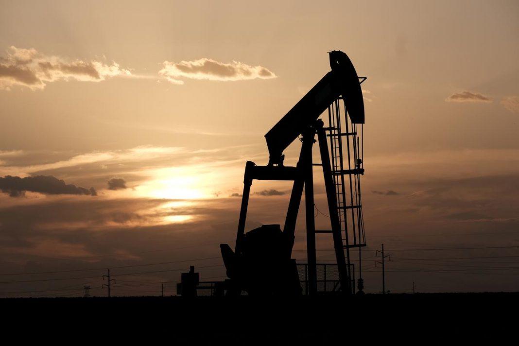 Oil pump jacks work at sunset near Midland, Texas, U.S., August 21, 2019.