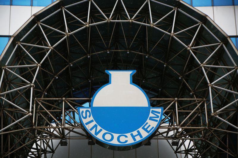 A logo of Sinochem is seen outside an office building of Sinochem in Beijing, China