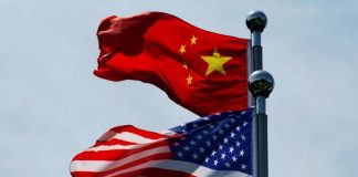 Chinese and U.S. flags flutter near The Bund, before U.S. trade delegation meet their Chinese counterparts for talks in Shanghai, China