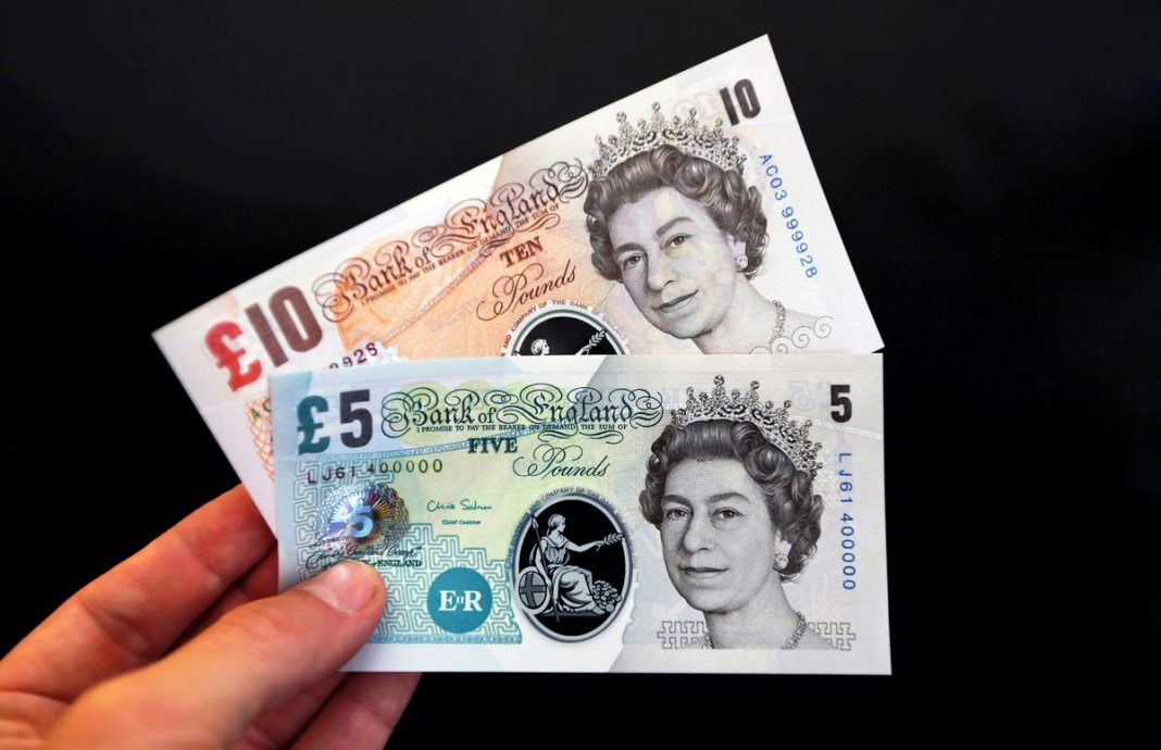Sample polymer five and ten pound banknotes displayed at the Bank of England in London, Britain, September 10, 2013.