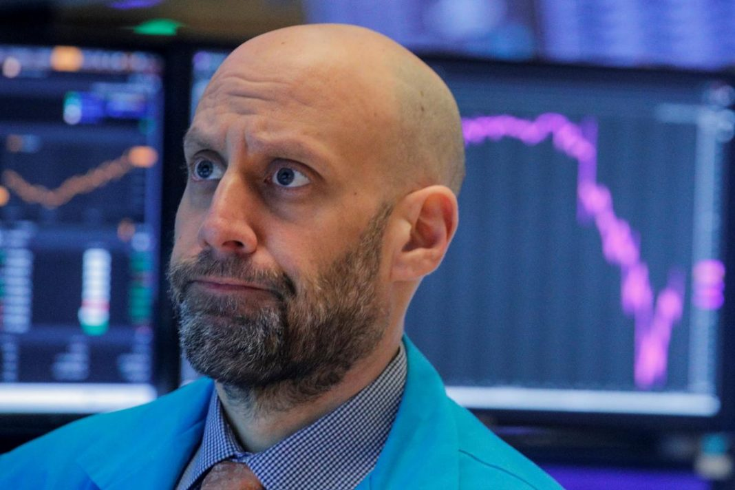 Traders work on the floor at the New York Stock Exchange (NYSE) in New York, U.S., March 3, 2020.