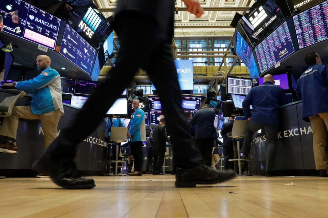 Traders work on the floor at the New York Stock Exchange (NYSE) in New York, U.S., March 2, 2020.