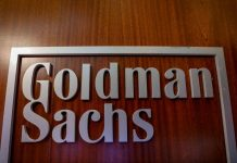 The Goldman Sachs company logo is seen in the company's space on the floor of the New York Stock Exchange
