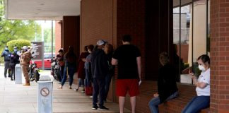 People who lost their jobs wait in line to file for unemployment following an outbreak of the coronavirus disease (COVID-19), at an Arkansas Workforce Center in Fort Smith, Arkansas, U.S