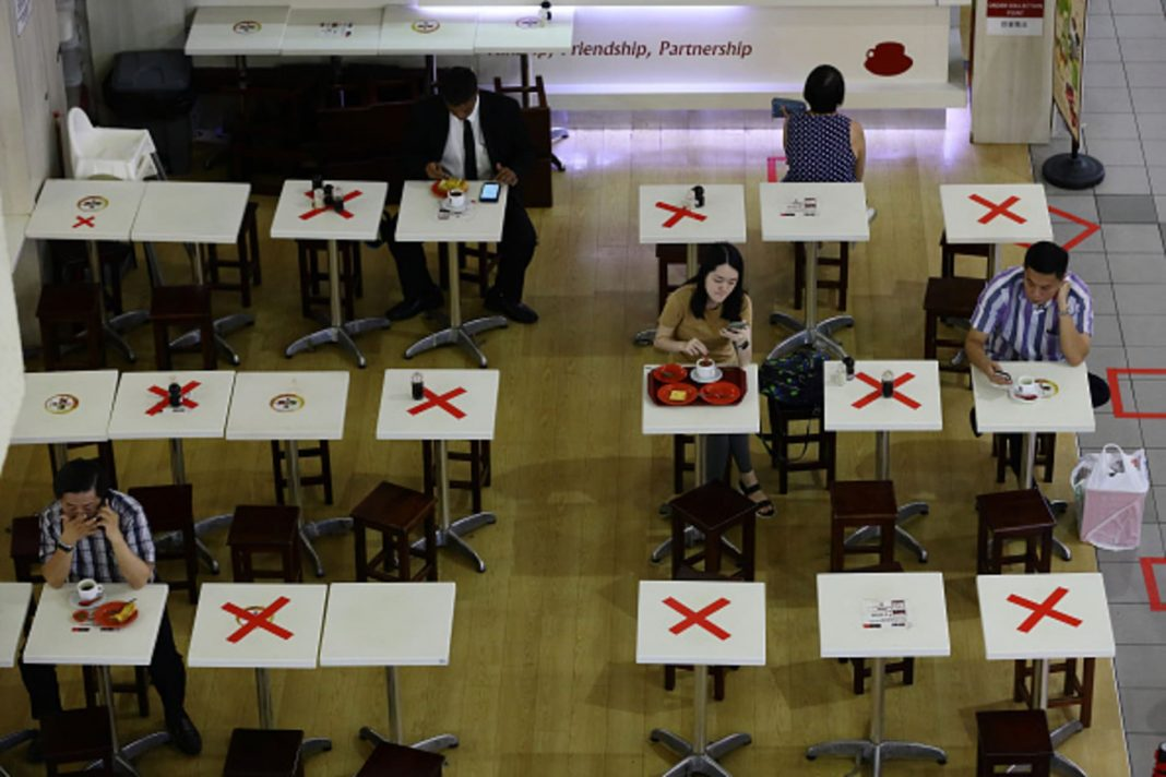 A food outlet in Singapore placed markers on selected tables to separate diners as authorities implement stricter social-distancing measures to combat the coronavirus outbreak.