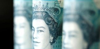 British five pound banknotes are seen in this picture illustration taken