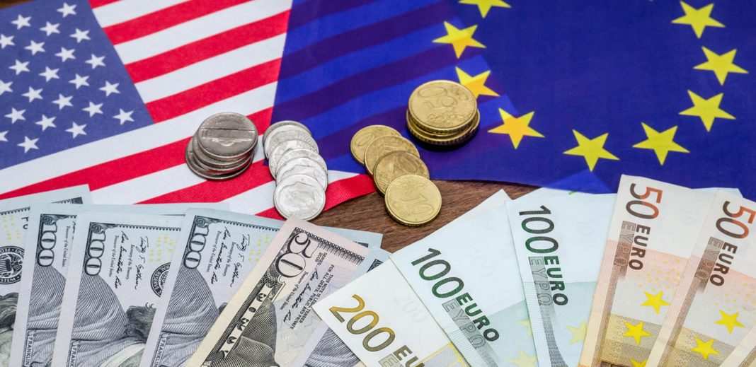 Dollars and euro with flag in table