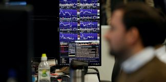 Global share markets dipped into the red on Wednesday as warnings of the worst global recession since the 1930s underlined the economic damage done during the coronavirus panemdic even as some countries try to re-open for business.