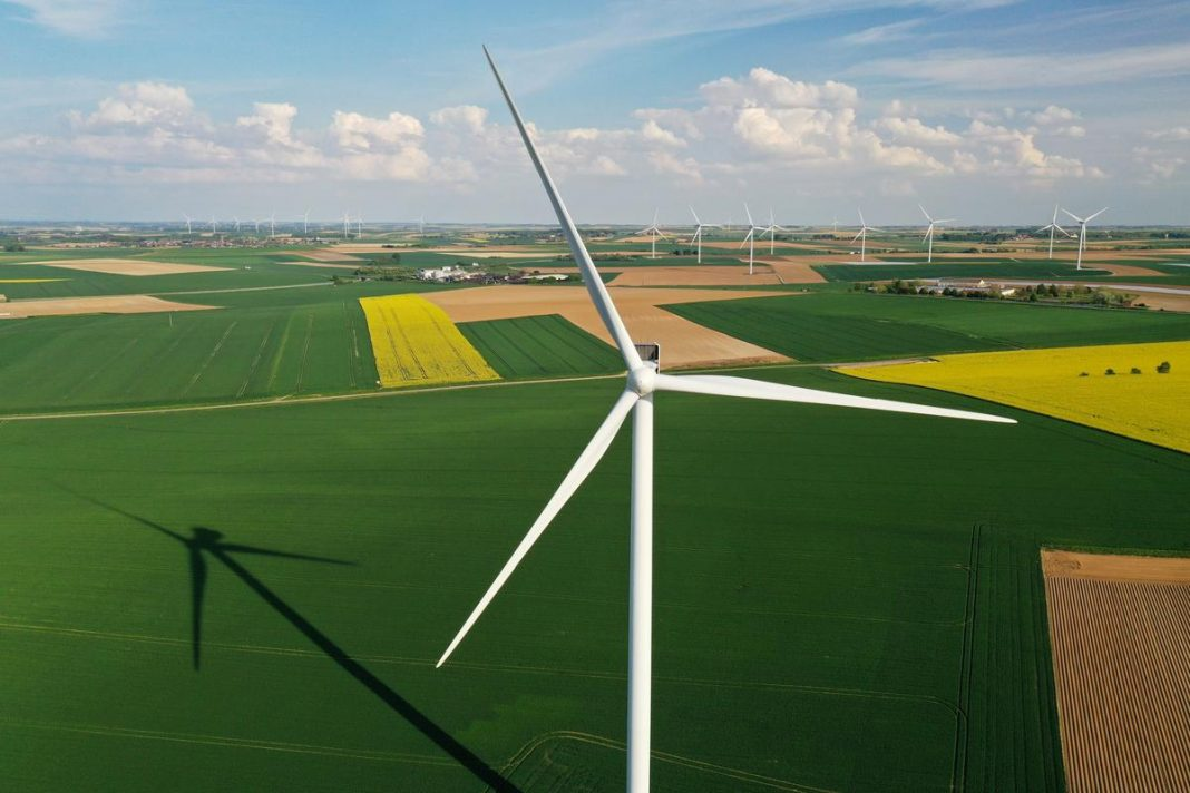 An aerial view shows power-generating windmill turbines in a wind farm in Graincourt-les-Havrincourt, France
