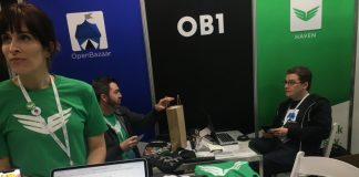 OB1 staff show off OpenBazaar at a 2019 conference.