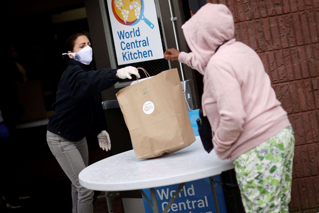 New Jersey First Lady Tammy Murphy hands out bags containing meals, face masks and other personal protective supplies to residents in need outside the NAN Newark Tech World during the outbreak of the coronavirus disease (COVID-19) in Newark, New Jersey