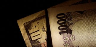 Japan Yen and U.S. Dollar notes are seen
