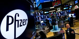 A logo for Pfizer is displayed on a monitor on the floor at the New York Stock Exchange (NYSE) in New York, U.S., July