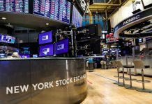A nearly empty trading floor is seen as preparations are made for the return to trading at the New York Stock Exchange (NYSE) in New York, U.S., May